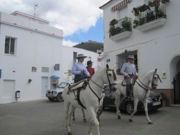 Side saddle and elegant whites.