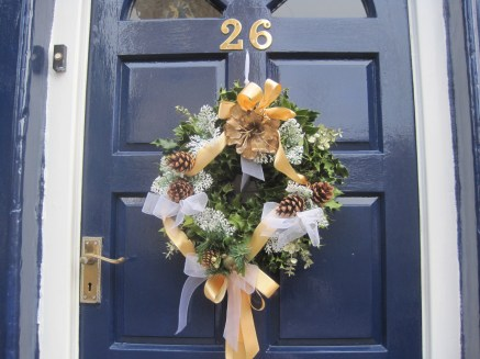 Just a few Christmas wreaths are left on the doors
