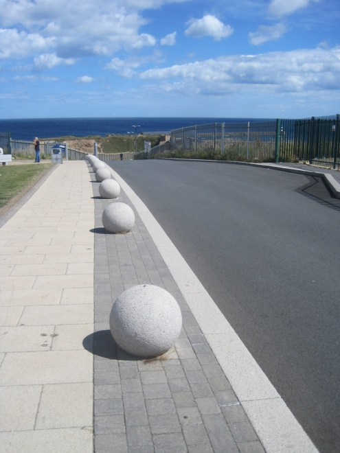 The road drops down into the harbour