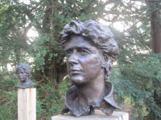 Several busts gaze at each other across a glade