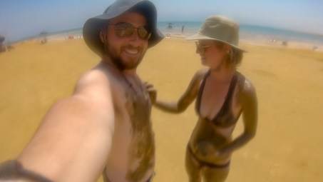 getting covered in mud at the dead sea