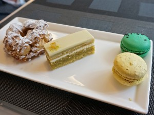Parisian mini desserts at the Sofitel. Paris Brest, orange pistachio gateau and green tea black sesame and banana hazelnut macarons