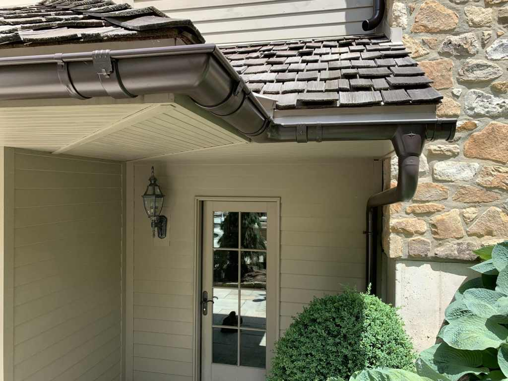 """Zambelli Euro Gutter in 6"""" Bronze Galvanized Steel, on a French Country Style Custom Home"""