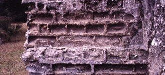 Brick wall incorrectly repaired with cement