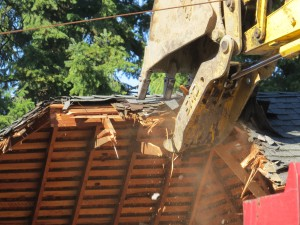 Demolition of 3419 NE 35th Place (photo courtesy of Barbara Strunk)