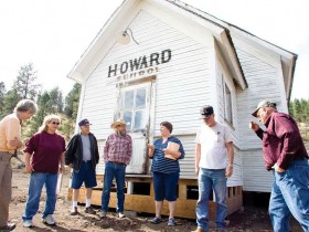 Photo Credit: Kevin Sperl, Central Oregonian - Sharon Allured (far left), Val Grubbe, Bill Grubbe, Gerry Grubbe, Lucy Woodward, Bill Quant, and Merle Williams gather around the recently relocated Howard School building.