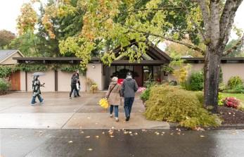 Tour-goers enter a Rummer home