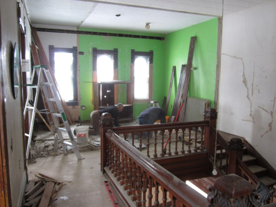 The offending wall gone. Incredible. The stair balustrade parallel to the triple stained-glass windows was originally much closer to the windows, as it will be when the stair is fully restored.
