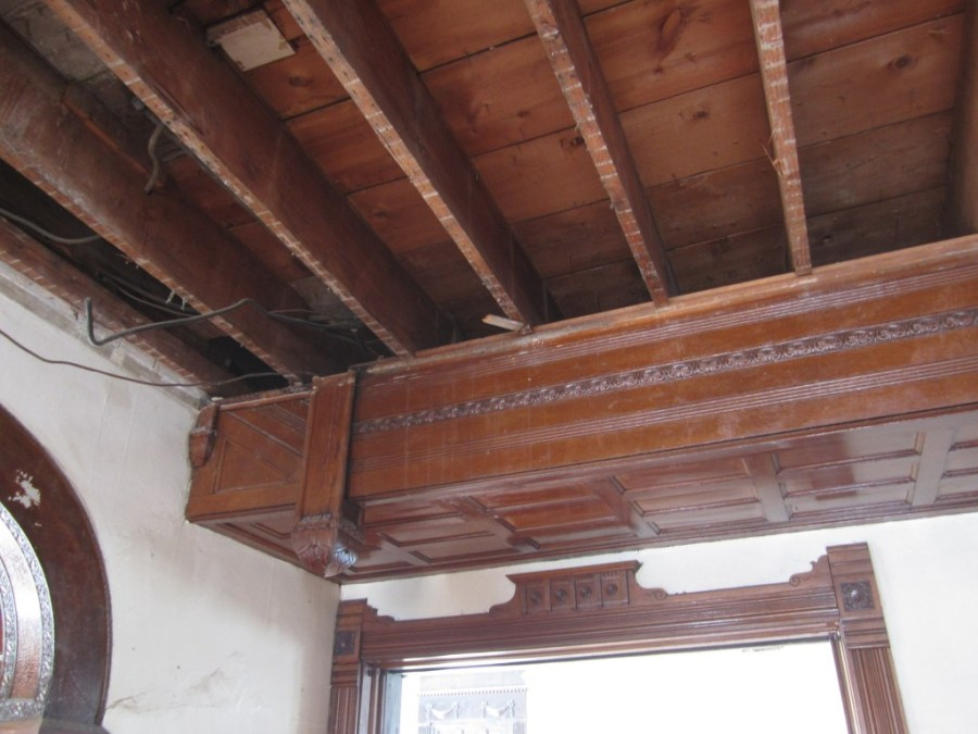 The non-original 1920s beams sat on the original 1894 landing, about 18-inches below the second floor.