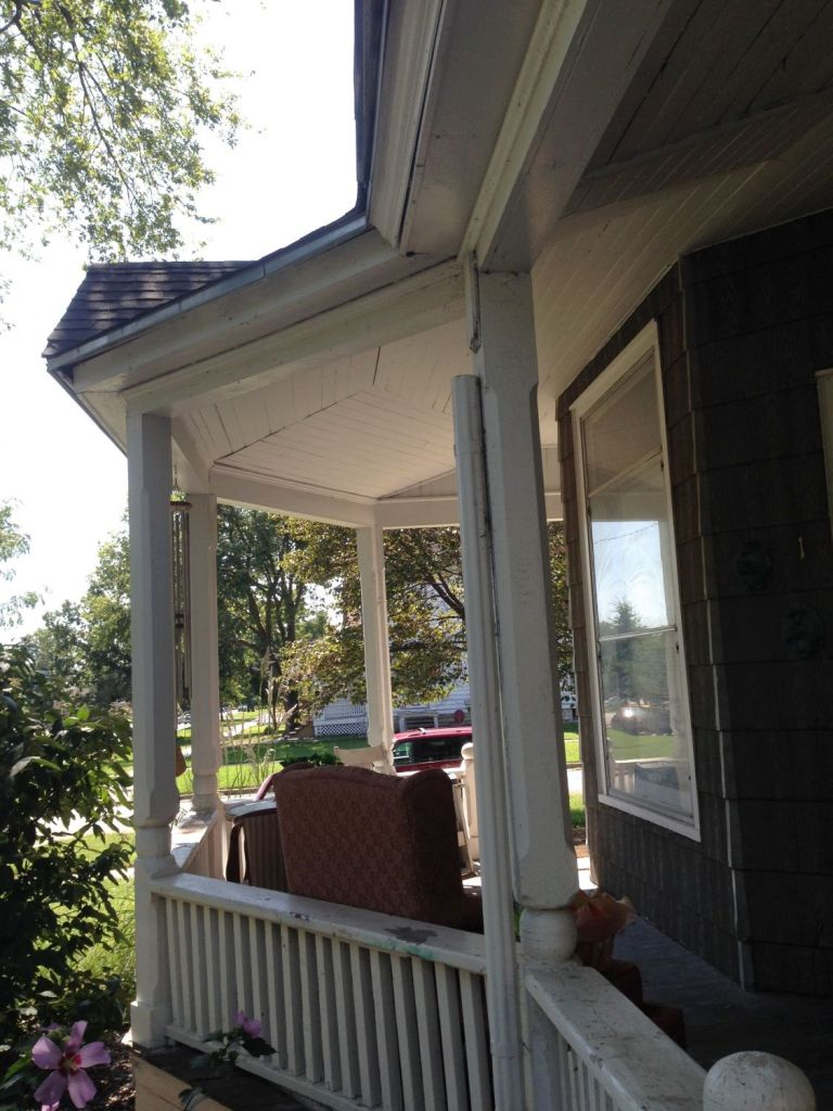 While not readily apparent in the image, the porch ceiling is not FLAT as is the standard, but rather ARCHES up to follow the roof line. Very cool in person.