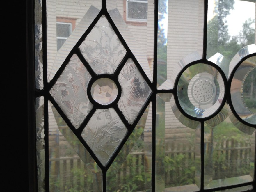 An incredible window tucked under the stair. Note the detailing.