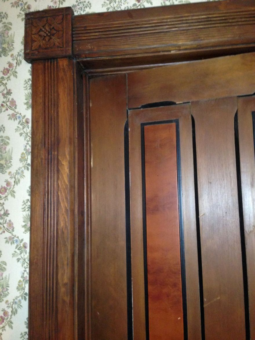 I believe that the doors are 1870s, and the trim is 1890s. I also suspect that all the first-floor trim was painted originally; its is not high quality wood. The painted finish may have imitated a better grade of wood. This was not uncommon to the period.