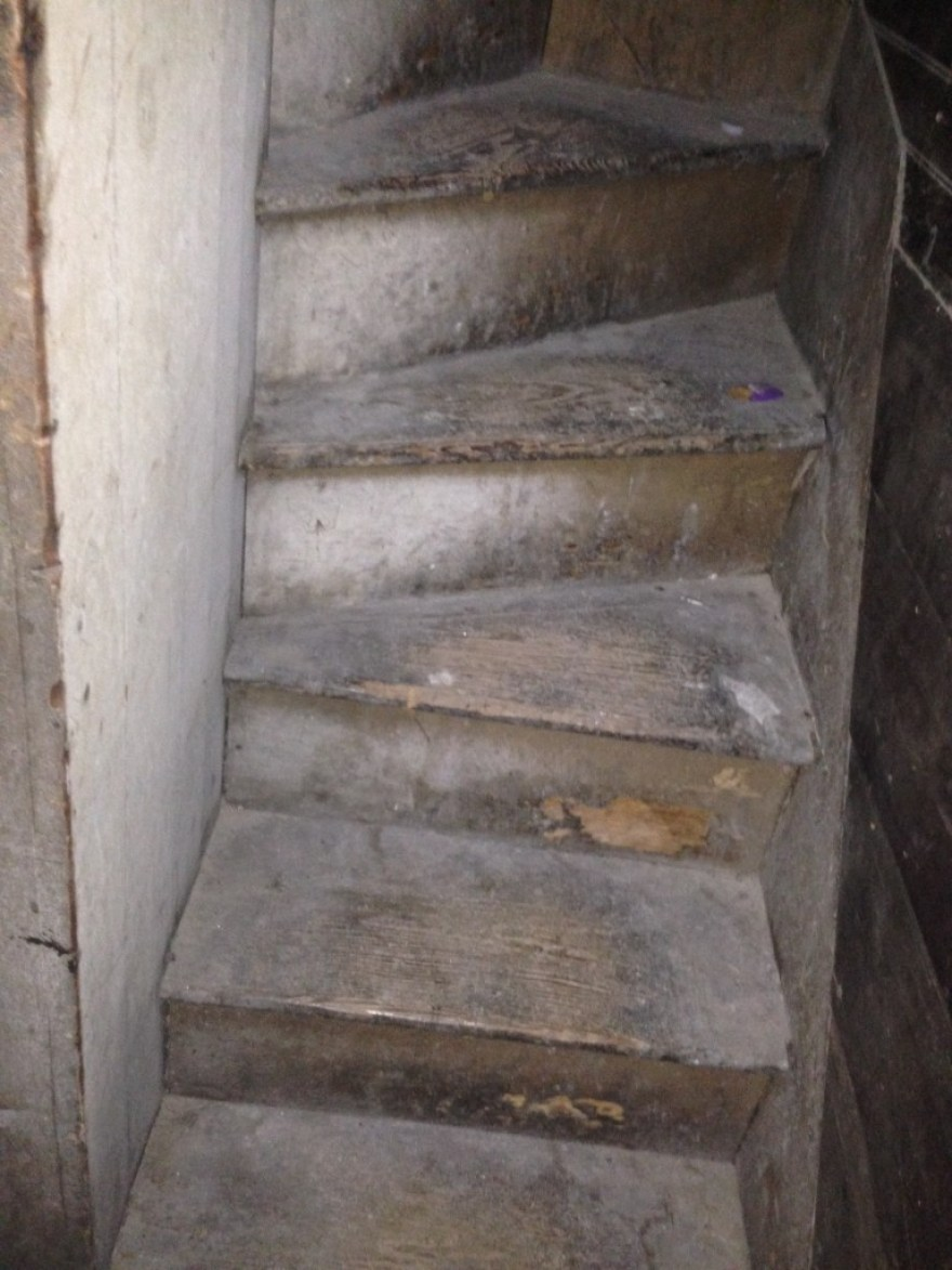 Incredibly, the original stair to the second level is in situ. If I were five punds heavier I would not have, perhaps, made it up the stairs. No image can convey how petite and narrow the stairs are. I find this delightful to an extreme.