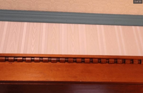 This is the top of a door opening. The detail is called a dentil, and Squires used this detail repeatedly, and normally in a highly eccentric dentil manner, as shown here.