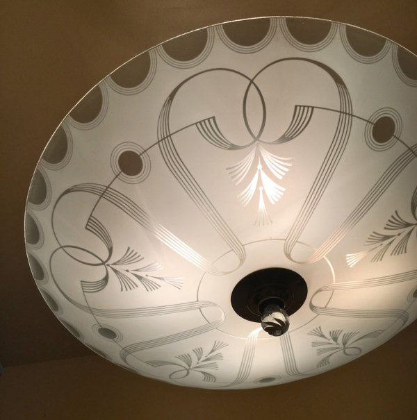 Oh my! he shade on the chandelier is stunning. I love love love its design, which is strongly evocative of its era.