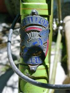 Griffon head badge