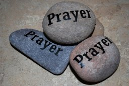This image has an empty alt attribute; its file name is rock-group-prayer.jpg