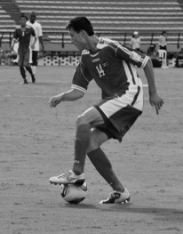 Jan Kuk Chol dribbles the ball (ENG-DPR)