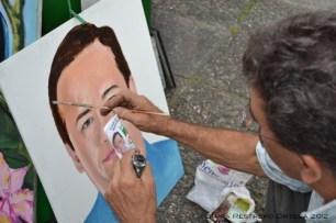 artista pinta a candidato político