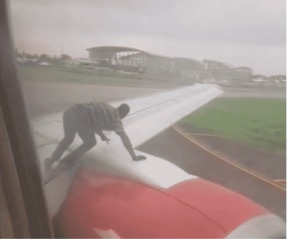 Guy Who Wants A Free Plane Ride Climbs On An Aircraft's Wing