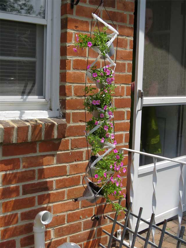 Recycled Planter with pink flowers