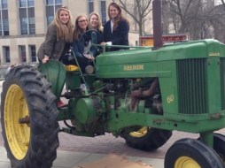 The girls enjoy the tractors out for Ag Day with Ag Club.