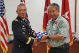 BG Tamashiro presents Gerald Takase with his flag