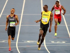 RIO DE JANEIRO, BRAZIL - AUGUST 17: Andre de Grasse of Canada (L) and Usain Bolt of Jamaica (C) react after competing in the Men's 200m Semifinals on Day 12 of the Rio 2016 Olympic Games at the Olympic Stadium on August 17, 2016 in Rio de Janeiro, Brazil. (Photo by Ian Walton/Getty Images)
