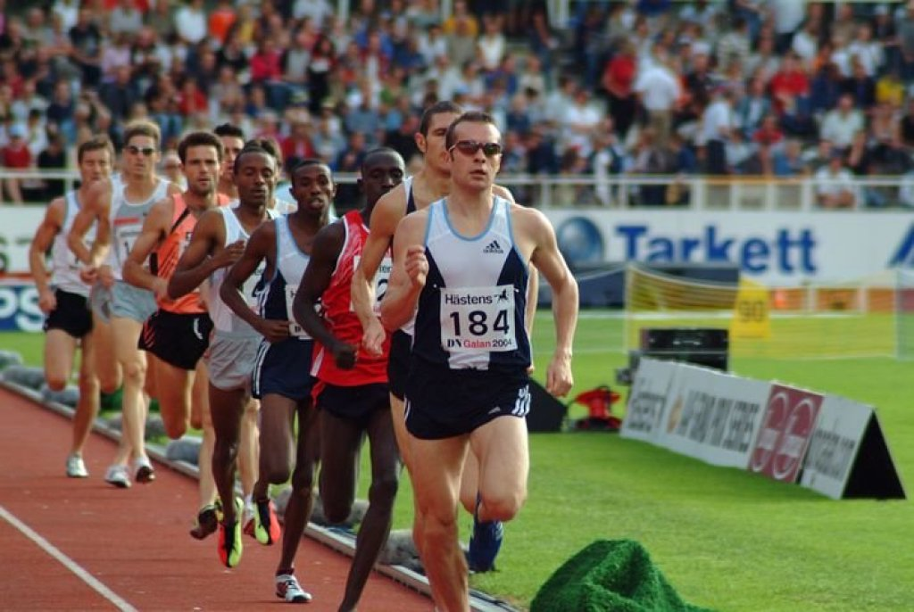 Long distance runners in a track event.