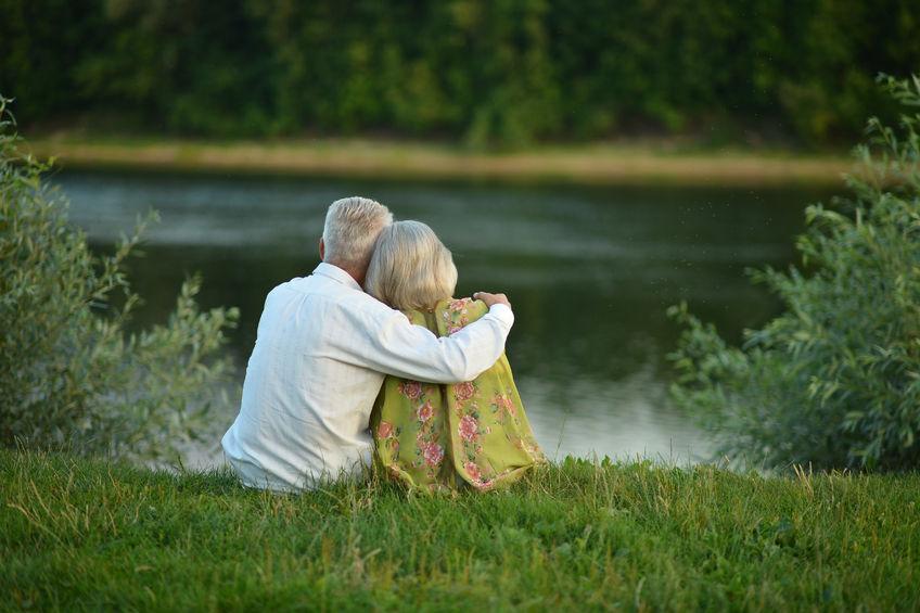 47313521 - happy senior couple in summer near lake