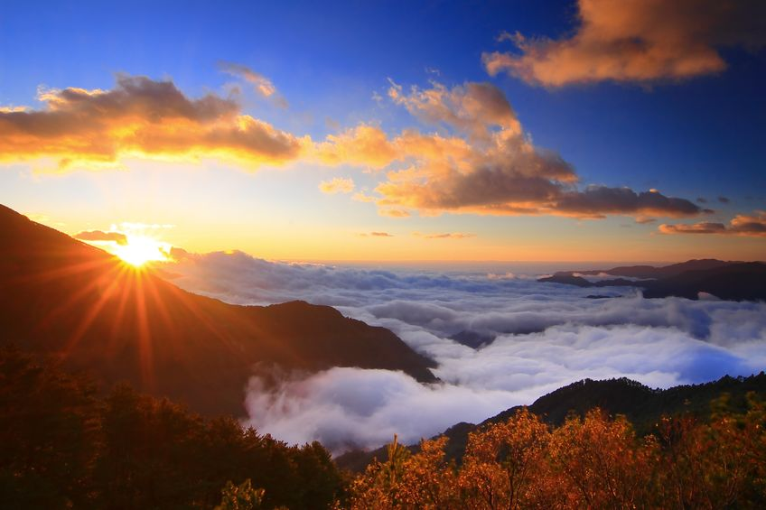 10749753 - amazing sunrise and sea of cloud with mountains and tree