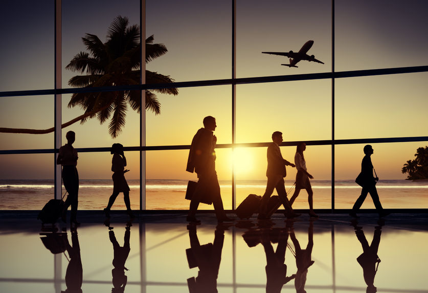 41335798 - back lit business people traveling airplane airport concept