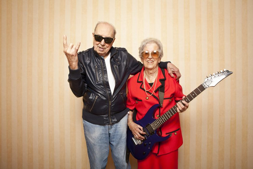 13787070 - cool fashion elder couple with electric guitar