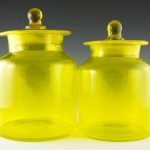 Hand-blown vintage kitchen canister set with ground necks to match the lid inserts.