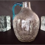 Clear crackle jug with applied blue handle, Blenko Art Glass pattern #417 or possibly made by Pilgrim Art Glass who also made this exact form.