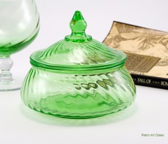 The swirl pattern was made by many elegant makers of the 1920s-1940s.  This lovely box may have been made by Imperial Glass or Duncan Miller Glass.