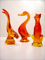 Viking Art Glass figurines, diving fish, sitting cat, and duck in persimmon.