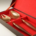 """The dining service utensils include a wonderfully stylized fork and spoon that are 10 3/4"""" long"""