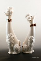 Tall ceramic poodles are porcelain with hand painted enamel details. Made in USA.