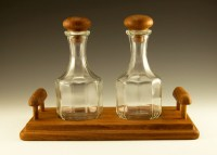 Well-preserved Mid-Century Modern teakwood condiment set made of genuine teakwood and Italian glass.