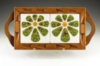 This Flower Power hippie era kitchen trivet was made in the 1960's.
