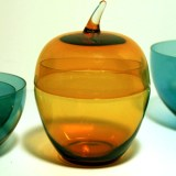 This retro modern stylized apple canister is finely hand blown with delicate amber glass. The clear glass stem is applied.
