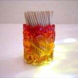 A beautiful little piece, this Amberina glass toothpick holder is made by Kanawha Art Glass.
