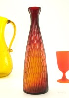 Attention grabbing carved art glass bottle vase looks stunning when light shines through.