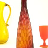 Attention grabbing carved art glass bottle vase looks stunning when light shines through.