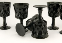 These black glass goblets are made of thick, opaque solid black glass. Hard to find today, especially in black, and in quantities.