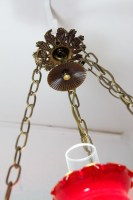Comes with about 30' of chain. The lamp turns off and on via the knob in the center of the oval metal piece at the base of the lamp.