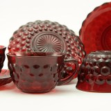 Set of Royal Ruby Bubble cups and saucers. Includes four saucers and four cups.