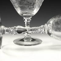 The Wildflower etched bowls were blown from and 6-panel optic mold. The intricate stem was formed in a mold. The bowl and foot are hand-applied to the stem. Made of top-notch crystal.