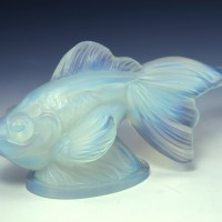 The Art Deco crowd fell hard the beautiful, haunting color and Sabino provided it in popular forms of the day. Japanese decor was all the rage, and this Japanese fish fit their decor taste perfectly.